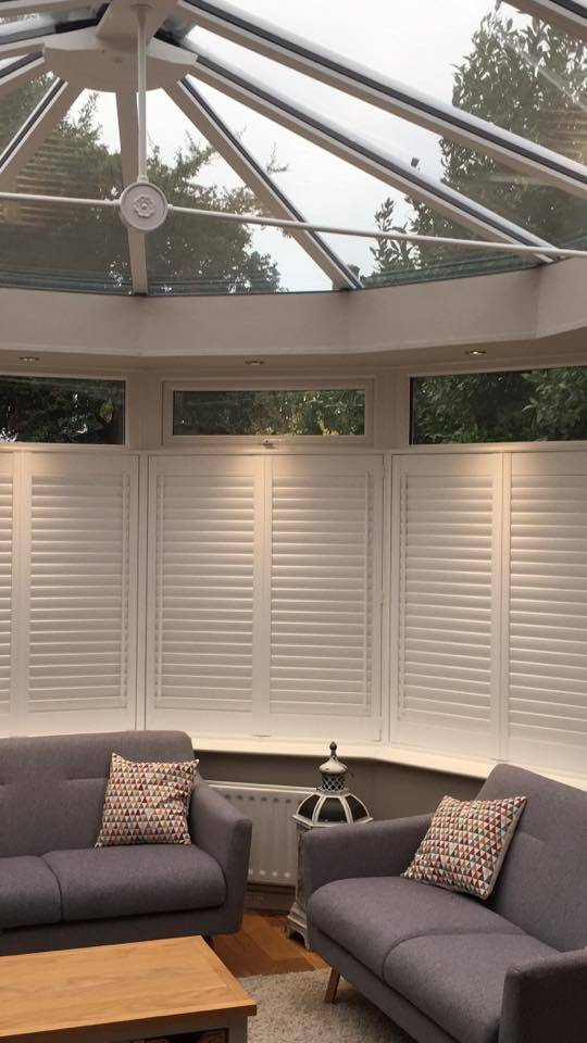 White Wooden Cafe Style Shutter in Conservatory